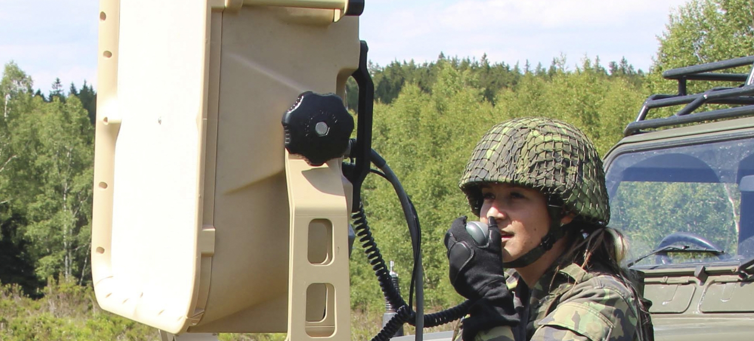Picture of a Czech soldier using an LRAD device in the field