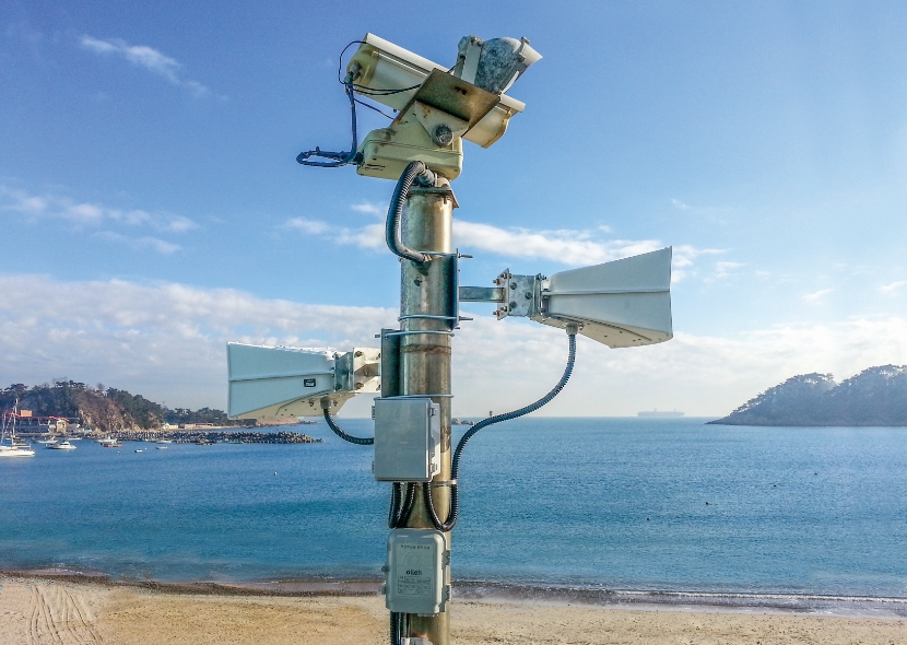 Picture of an LRAD device on a beach.