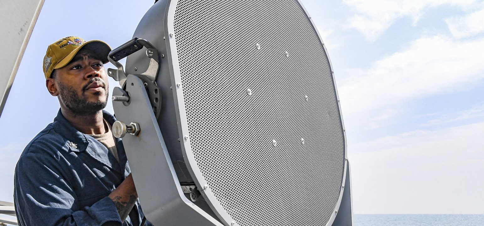 Image of a Sailor using an LRAD 1000Xi