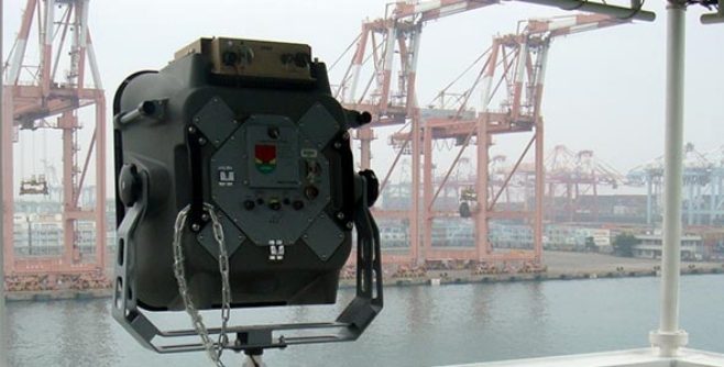 Image of an LRAD device at a shipyard